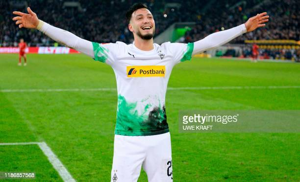 Moenchengladbach's Algerian defender Ramy Bensebaini celebrates after scoring at the end of the German first division Bundesliga football match...