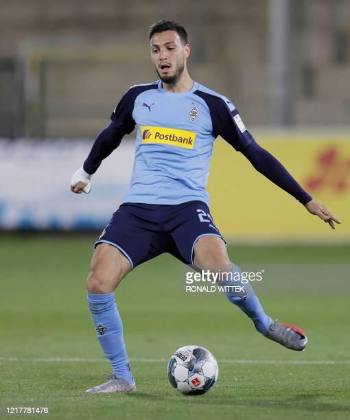 Moenchengladbach's Algerian defender Ramy Bensebaini plays the ball during the German first division Bundesliga football match SC Freiburg v Borussia...