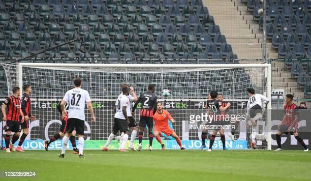 Moenchengladbach's Algerian defender Ramy Bensebaini scores the 3-0 during the German first division Bundesliga football match between Borussia...