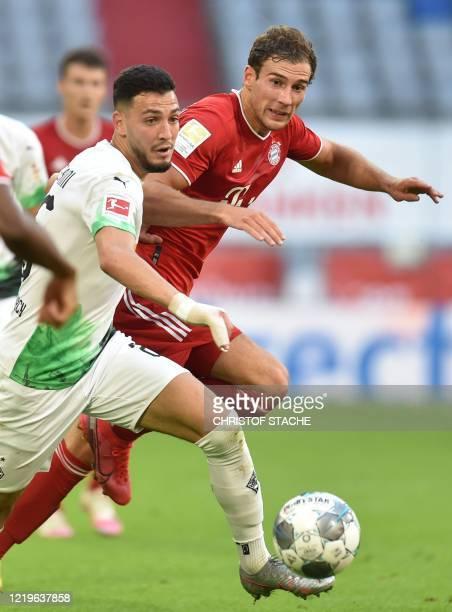 Moenchengladbach's Algeria's defender Ramy Bensebaini and Bayern Munich's midfielder Leon Goretzka vie for the ball during the German first division...