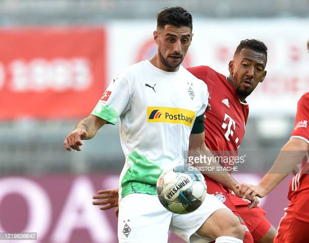 Moenchengladbach's Algeria's defender Ramy Bensebaini and Bayern Munich's defender Jerome Boateng vie for the ball during the German first division...