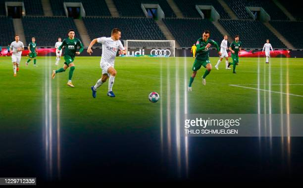 Moenchengladbach's Austrian defender Stefan Lainer and Augsburg's Brazilian defender Amaral Borduchi Iago vie for the ball during the German first...
