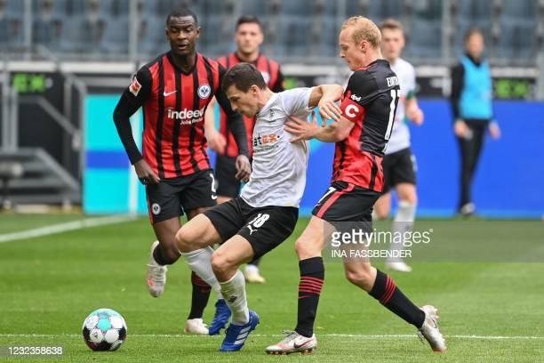 Moenchengladbach's Austrian defender Stefan Lainer and Frankfurt's German midfielder Sebastian Rode vie for the ball during the German first division...