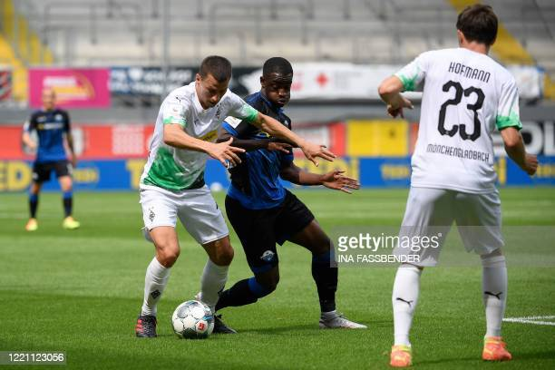 Moenchengladbach's Austrian defender Stefan Lainer and Paderborn's Nigerian defender Jamillu Collins vie for the ball during the German first...