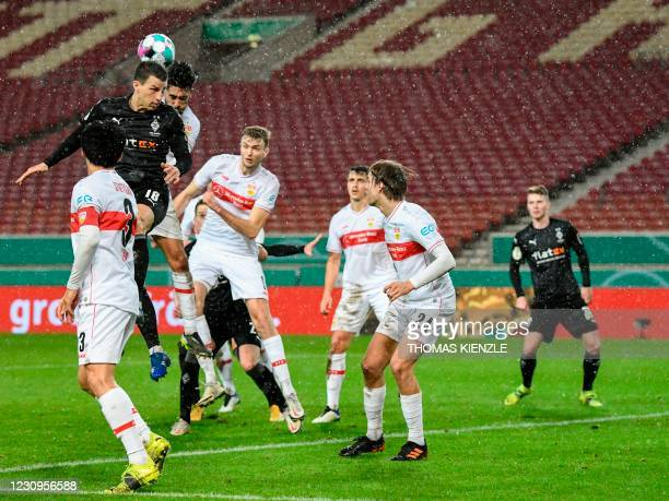 Moenchengladbach's Austrian defender Stefan Lainer jumps to head the ball during the German Cup last 16 football match between VfB Stuttgart and...