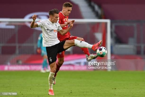 Moenchengladbach's Austrian midfielder Hannes Wolf and Bayern Munich's German midfielder Joshua Kimmich vie for the ball during the German first...