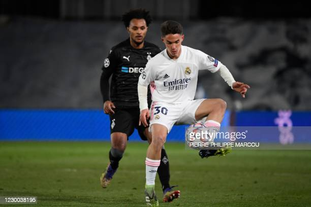 Moenchengladbach's Austrian midfielder Valentino Lazaro challenges Real Madrid's Spanish midfielder Sergio Arribas during the UEFA Champions League...