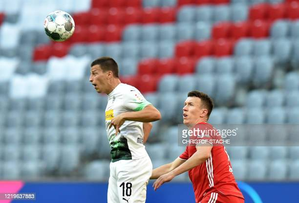Moenchengladbach's Austria's defender Stefan Lainer and Bayern Munich's Croatian striker Ivan Perisic vie for the ball during the German first...