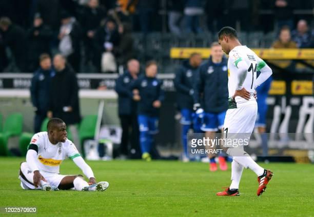 Moenchengladbach's Brazilian forward Raffael and Moenchengladbach's Swiss midfielder Denis Zakaria react after the German first division Bundesliga...