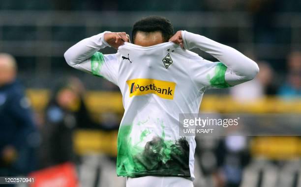 Moenchengladbach's Brazilian forward Raffael reacts after the German first division Bundesliga football match Borussia Moenchengladbach vs TSG 1899...