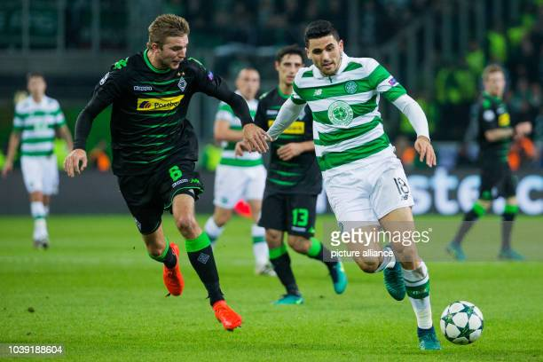 Moenchengladbach's Christoph Kramer and Glasgow's Tom Rogic vie for the ball during the Champions League soccer match between Borussia...