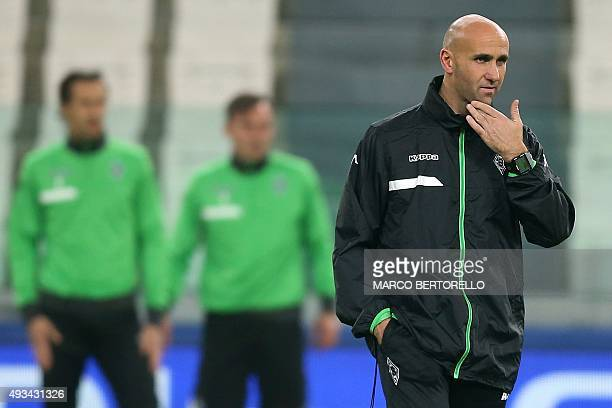 Moenchengladbach's coach Andre Schubert from Germany takes part in a training session on the eve of the UEFA Champions League football match Juventus...