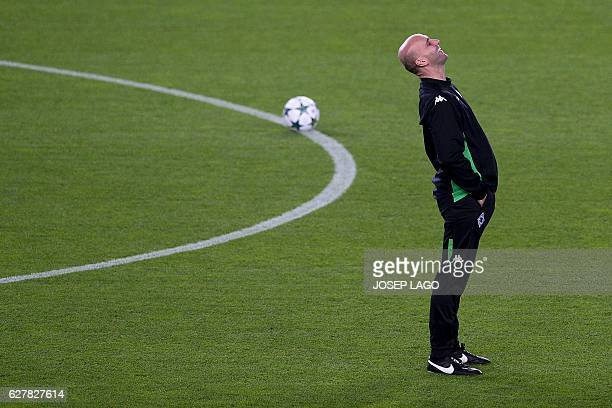 Moenchengladbach's coach Andre Schubert smiles during a training session at the Camp Nou stadium in Barcelona on December 5 on the eve of the UEFA...