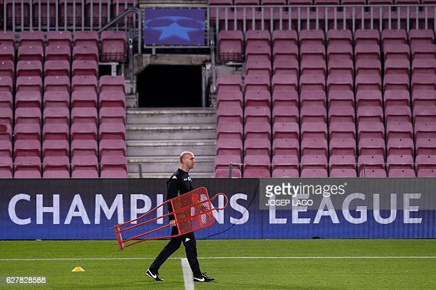 Moenchengladbach's coach Andre Schubert takes part in a training session at the Camp Nou stadium in Barcelona on December 5 on the eve of the UEFA...