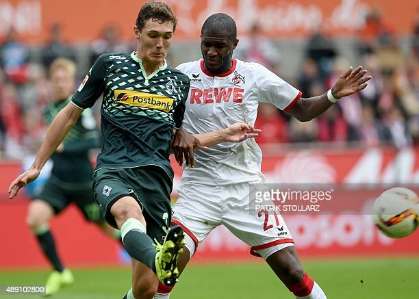 Moenchengladbach's Danish defender Andreas Christensen and Cologne's Cologne's French forward Anthony Modeste vie for the ball during the German...