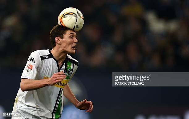 Moenchengladbach's Danish defender Andreas Christensen heads the ball during the German first division Bundesliga football match FC Schalke 04 v...