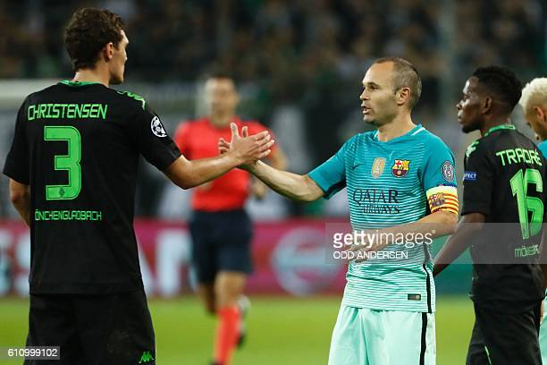 Moenchengladbach's Danish defender Andreas Christensen shakes hands with Barcelona's midfielder Andres Iniesta after the UEFA Champions League...