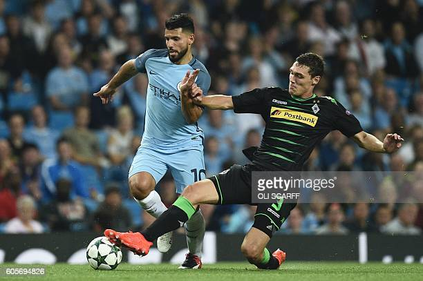Moenchengladbach's Danish defender Andreas Christensen tackles Manchester City's Argentinian striker Sergio Aguero during the UEFA Champions League...