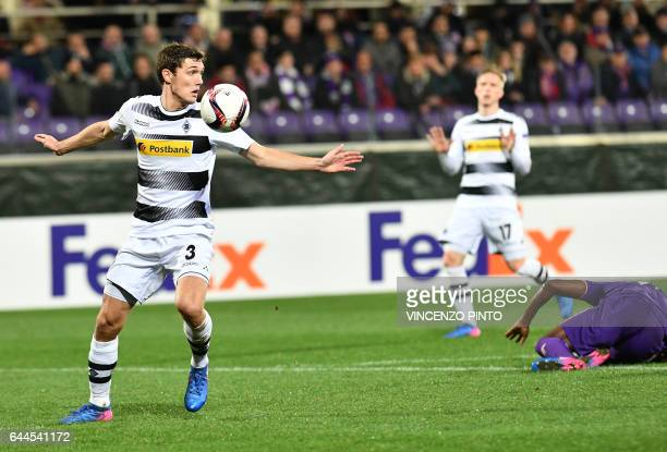 Moenchengladbach's defender Andreas Christensen eyes the ball during the UEFA Europa League round of 32 secondleg football match between Fiorentina...