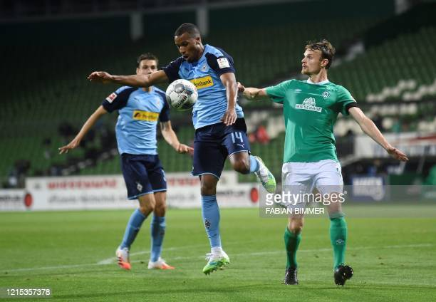 Moenchengladbach's French forward Alassane Plea and Bremen's German midfielder Christian Gross vie for the ball during the German first division...