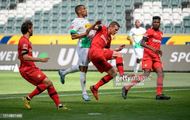 Moenchengladbach's French forward Alassane Plea and Leverkusen's German defender Sven Bender vie for the ball during the German first division...
