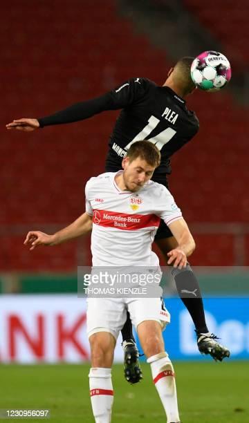 Moenchengladbach's French forward Alassane Plea and Stuttgart's German defender Waldemar Anton vie for the ball during the German Cup last 16...