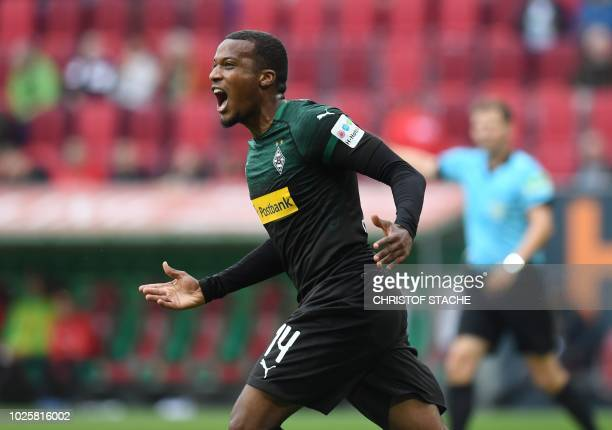 Moenchengladbach's French forward Alassane Plea celebrates after scoring the 11 during the German first division Bundesliga football match FC...
