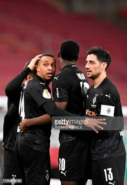 Moenchengladbach's French forward Alassane Plea celebrates with team mates scoring the 1-2 during the German Cup last 16 football match between VfB...