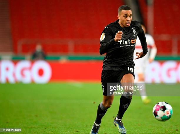 Moenchengladbach's French forward Alassane Plea runs with the ball during the German Cup last 16 football match between VfB Stuttgart and Borussia...