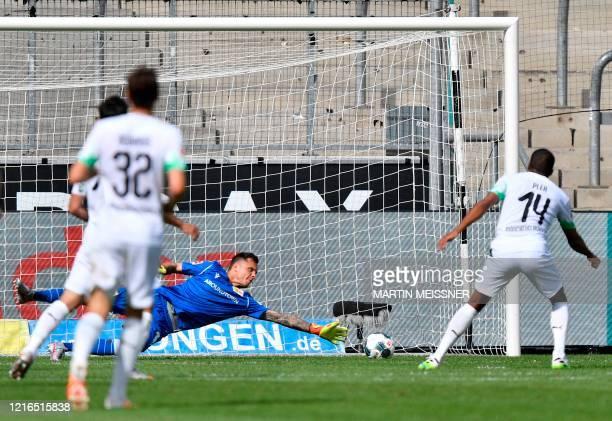 Moenchengladbach's French forward Alassane Plea scores the 41 during the German first division Bundesliga football match Borussia Moenchengladbach v...
