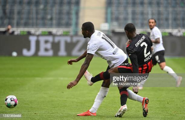 Moenchengladbach's French forward Marcus Thuram and Frankfurt's French defender Evan N'Dicka vie for the ball during the German first division...