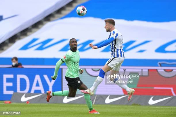 Moenchengladbach's French forward Marcus Thuram and Hertha Berlin's German defender Lukas Kluenter vie for the ball during the German first division...