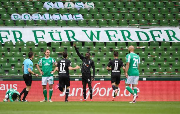 Moenchengladbach's French forward Marcus Thuram celebrates scoring his team's second goal during the German first division Bundesliga football match...