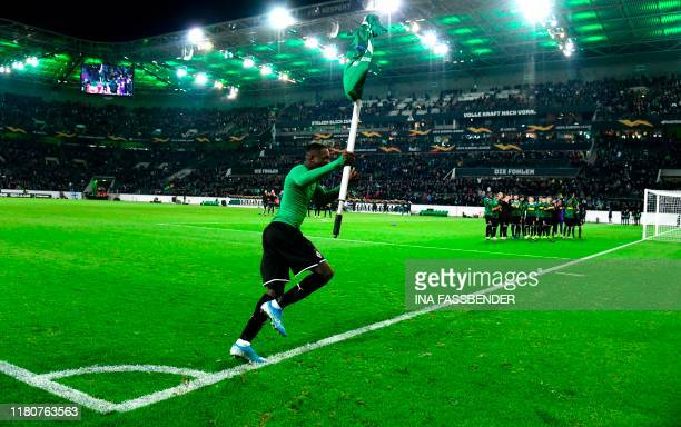 Moenchengladbach's French forward Marcus Thuram celebrates victory with the corner flag after the UEFA Europa League Group J football match Borussia...