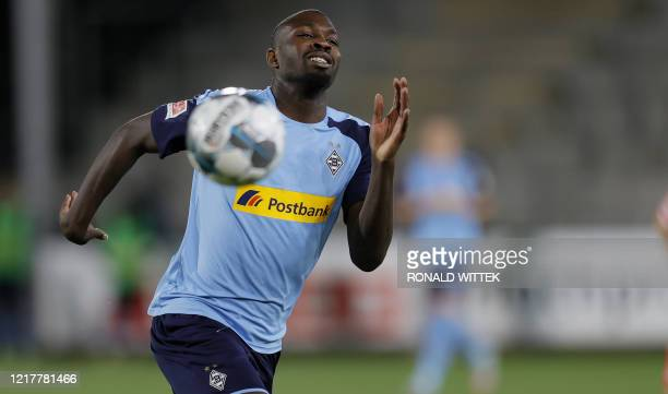 Moenchengladbach's French forward Marcus Thuram chases the ball during the German first division Bundesliga football match SC Freiburg v Borussia...