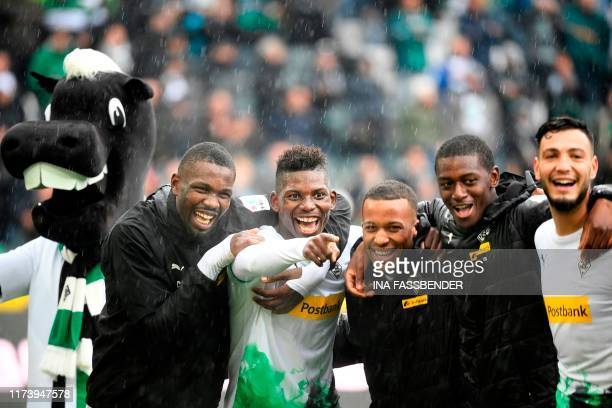 TOPSHOT Moenchengladbach's French forward Marcus Thuram Moenchengladbach's Swiss forward Breel Embolo and team mates celebrate the 51 victory after...