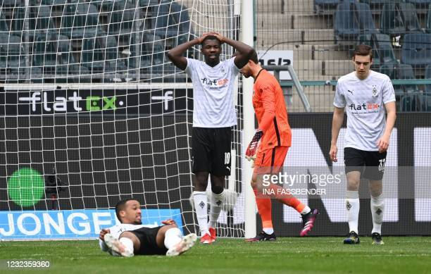 Moenchengladbach's French forward Marcus Thuram reacts after missing a chance during the German first division Bundesliga football match between...