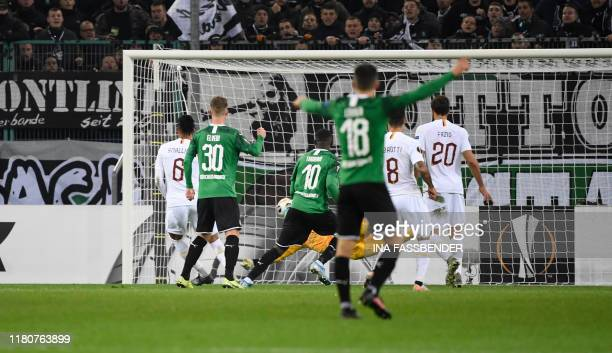 Moenchengladbach's French forward Marcus Thuram scores the winning 21 goal during the UEFA Europa League Group J football match Borussia...