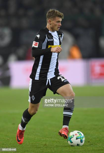 Moenchengladbach's French midfielder Mickael Cuisance runs with the ball during the German first division Bundesliga football match of Borussia...