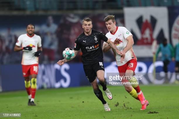 Moenchengladbach's German defender Louis Jordan Beyer and Leipzig's Norwegian forward Alexander Sorloth vie for the ball during the German first...