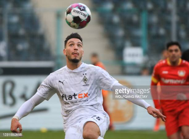 Moenchengladbach's German defender Louis Jordan Beyer eyes the ball during the German first division Bundesliga football match between Borussia...