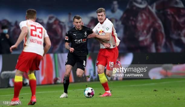 Moenchengladbach's German defender Louis Jordan Beyer vies with Leipzig's Norwegian forward Alexander Sorloth and Leipzig's German defender Marcel...