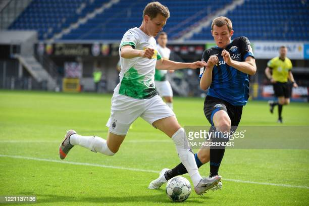 Moenchengladbach's German defender Matthias Ginter and Paderborn's German defender Luca Kilian vie for the ball during the German first division...