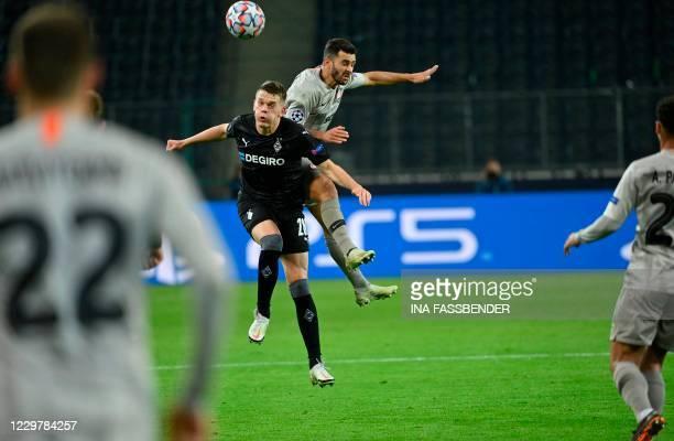 Moenchengladbach's German defender Matthias Ginter and Shakhtar Donetsk's Ukrainian forward Junior Moraes vie for the ball during the UEFA Champions...