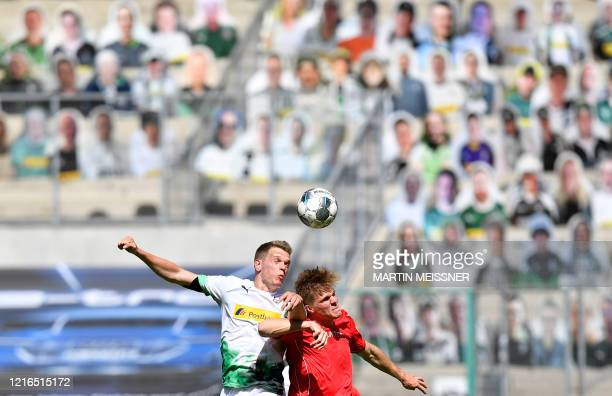 TOPSHOT Moenchengladbach's German defender Matthias Ginter and Union Berlin's German forward Marius Buelter vie for the ball during the German first...