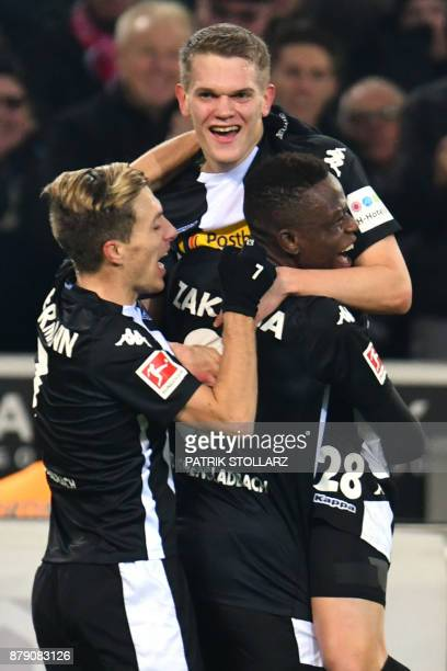 Moenchengladbach's German defender Matthias Ginter is congratulated by teammates after scoring a goal during the German First division Bundesliga...