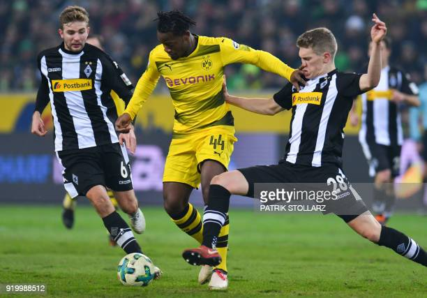 Moenchengladbach's German defender Matthias Ginter Moenchengladbach's German midfielder Christoph Kramer and Dortmund's Belgian striker Michy...