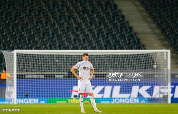 Moenchengladbach's German defender Matthias Ginter reacts after the German first division Bundesliga football match Borussia Moenchengladbach vs...