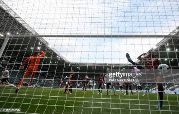 Moenchengladbach's German defender Matthias Ginter scores the 1-0 during the German first division Bundesliga football match between Borussia...