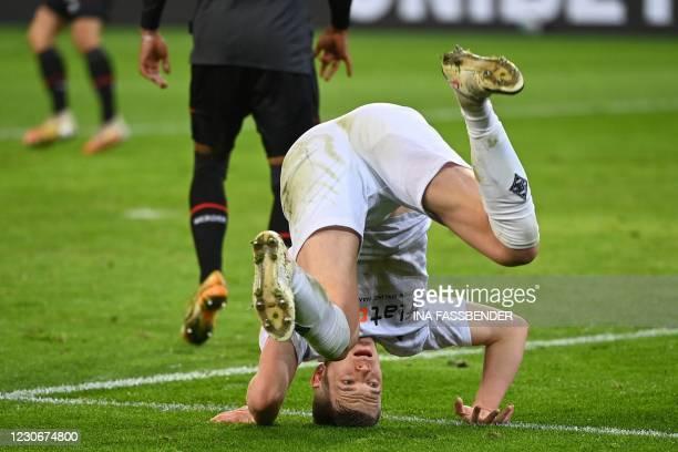 Moenchengladbach's German defender Matthias Ginter takes a tumble during the German first division Bundesliga football match Borussia...